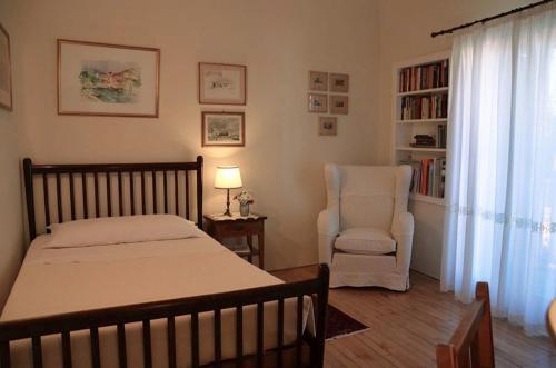 Cama ou camas em um quarto em Locanda Cipriani