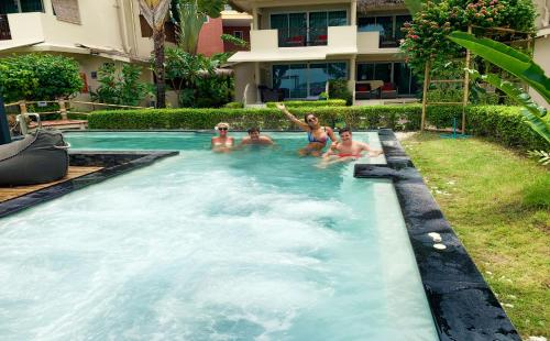 The swimming pool at or near Mama Beach Residence