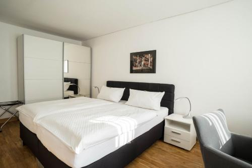 Ein Bett oder Betten in einem Zimmer der Unterkunft Hotel Bürger