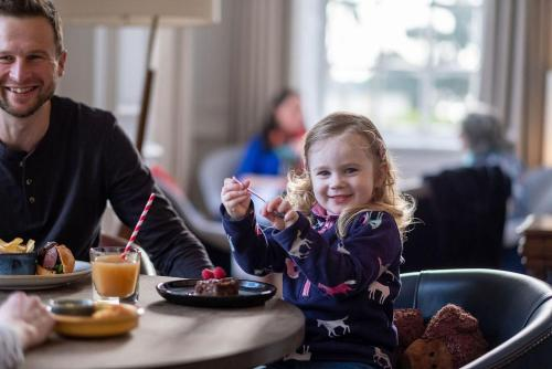A family staying at Fowey Hall - A Luxury Family Hotel