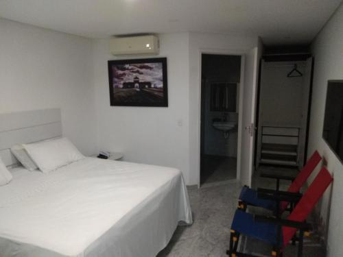 A bed or beds in a room at HOTEL MAR ABERTO OLINDA
