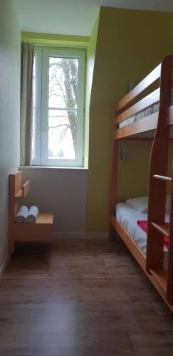 A bunk bed or bunk beds in a room at Domaine de Manehouarn