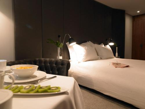 A bed or beds in a room at Altis Prime Hotel