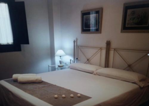 Cama o camas de una habitación en Realejo Calle Santiago 9, Centro
