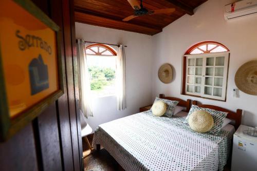 A bed or beds in a room at Hospedaria Tayrona