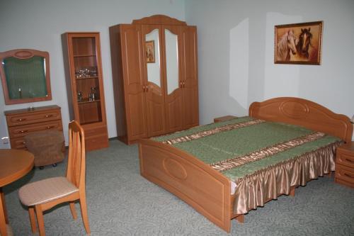 Кровать или кровати в номере Fortuna Hotel