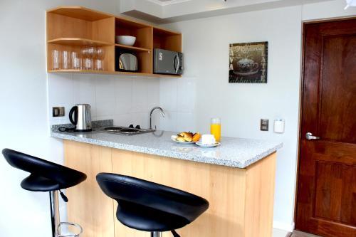 A cozinha ou cozinha compacta de Apart Hotel Providencia
