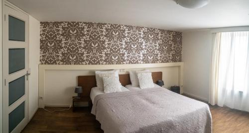 Кровать или кровати в номере B&B Posthoorn