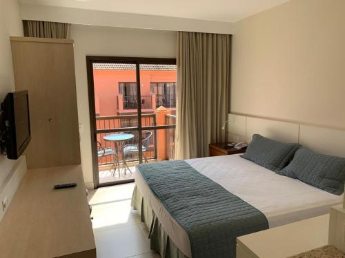 A bed or beds in a room at Jurerê Beach Village - Flat na Praia