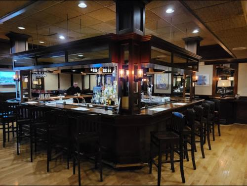 The lounge or bar area at Ramada by Wyndham Seekonk Providence Area