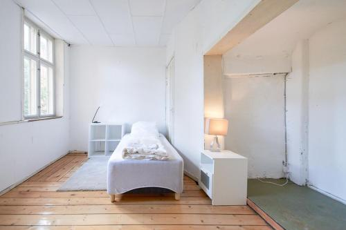 A bed or beds in a room at Prinsessegade 52