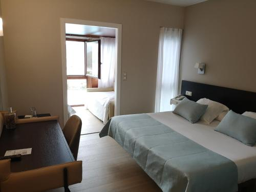 Cama o camas de una habitación en Hotel Herbeira