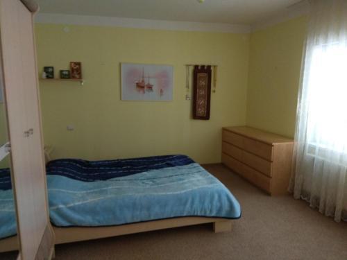 Кровать или кровати в номере Гостевой дом Адель