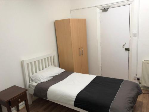 A bed or beds in a room at Central Hotel