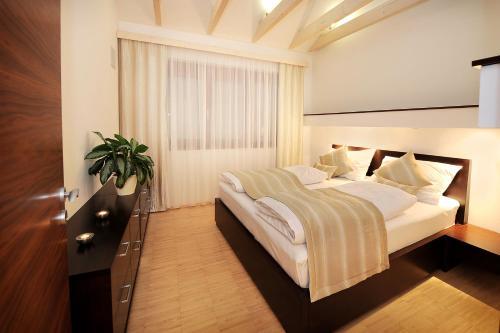 Postel nebo postele na pokoji v ubytování Hotel Biograf