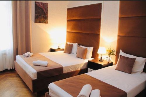 A bed or beds in a room at City Inn Boutique Hotel
