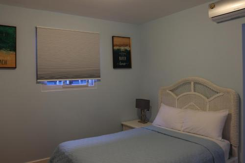 Кровать или кровати в номере Hotel Bocas Town