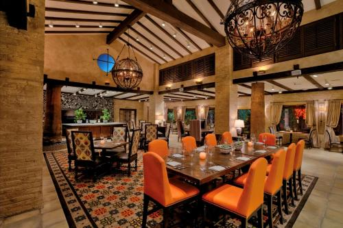 A restaurant or other place to eat at Royal Palms Resort and Spa, part of Hyatt