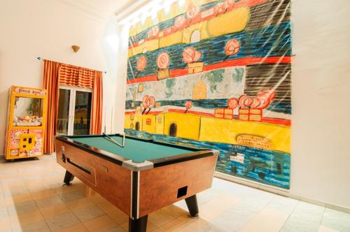 A pool table at Valsami Hotel Apartments