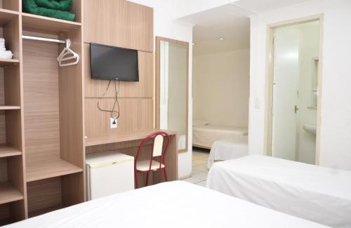 A bed or beds in a room at FICARE POA - 3min do Complexo Hospitalar Santa Casa