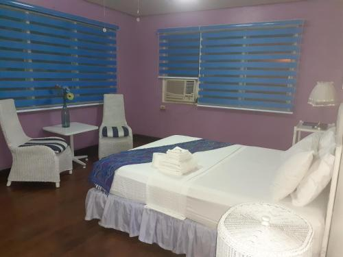 A bed or beds in a room at Casa Joaquin BnB