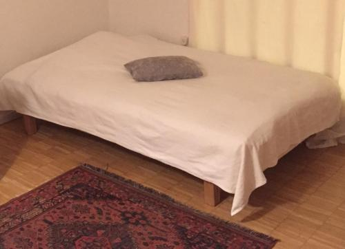 A bed or beds in a room at Södermalm Homestay