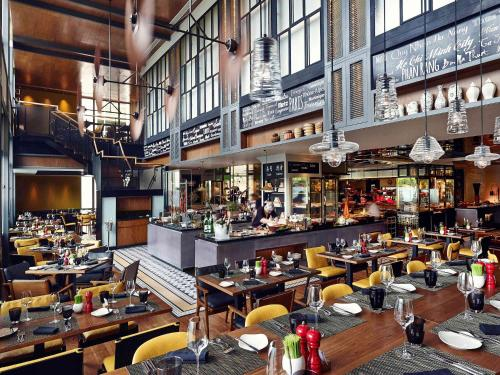A restaurant or other place to eat at Sofitel Saigon Plaza