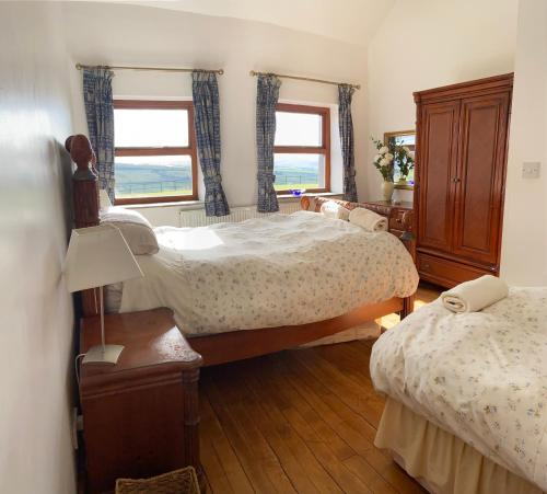 A bed or beds in a room at Herd House Holiday Homes