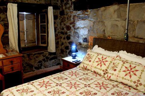 A bed or beds in a room at Pousada Casa Barp
