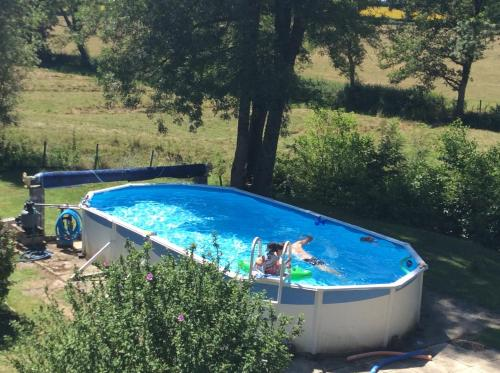 The swimming pool at or near Le Moulin Fargan