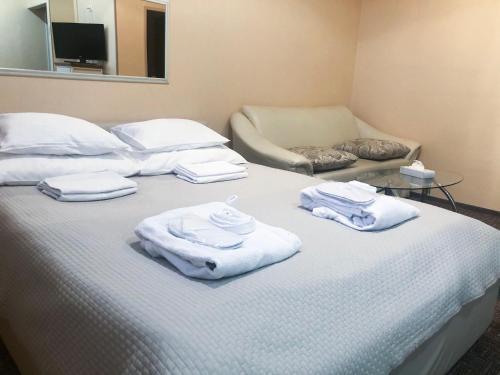 Кровать или кровати в номере Hotel Yes