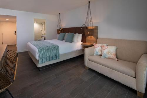 A bed or beds in a room at Amara Cay Resort