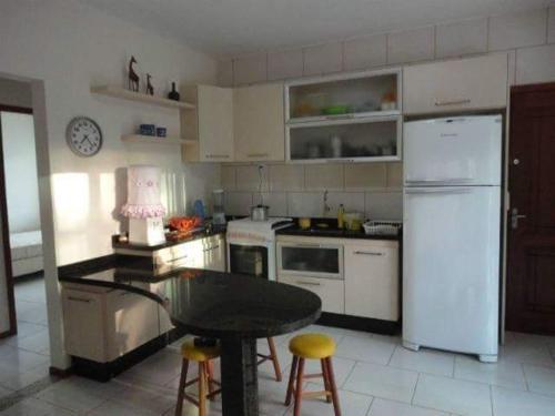 A kitchen or kitchenette at Casa do Giba