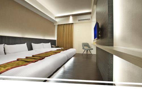 福岡1號溫泉飯店房間的床