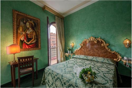 Cama ou camas em um quarto em Hotel Marconi