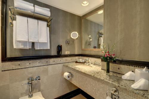 A bathroom at The Whitehall Hotel