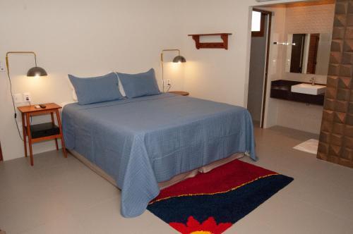 A bed or beds in a room at Club do Balanço Pousada e Restaurante