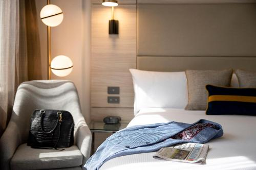 A bed or beds in a room at Novotel Sydney Parramatta