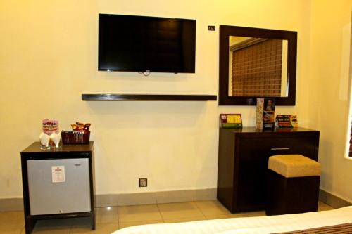 A television and/or entertainment center at Hotel Akbar International