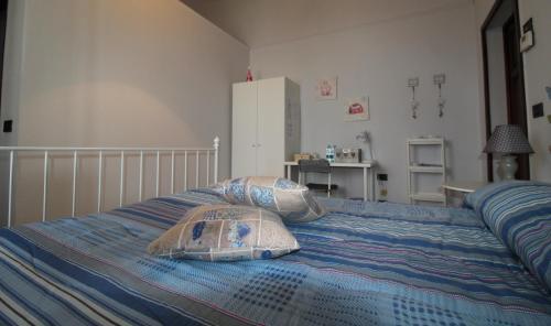 Letto o letti in una camera di Le Cascine