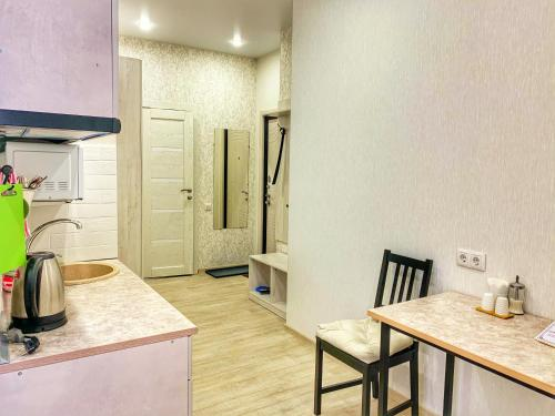 A kitchen or kitchenette at Гостиница Бастон на Никитина