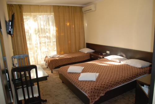 Кровать или кровати в номере Гостевой Дом Персона