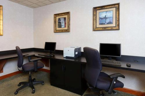 The business area and/or conference room at La Quinta by Wyndham Garden City