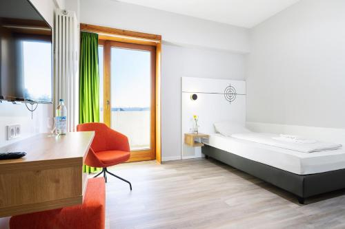 A bed or beds in a room at Hotel Olympia Schießanlage