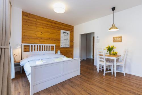 Posteľ alebo postele v izbe v ubytovaní Apartmán Hory - V srdci Tatier