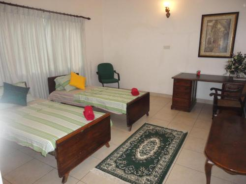 A bed or beds in a room at Peace of Mind Residencies