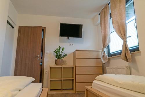 Postelja oz. postelje v sobi nastanitve Apartments Helena Kranjska Gora