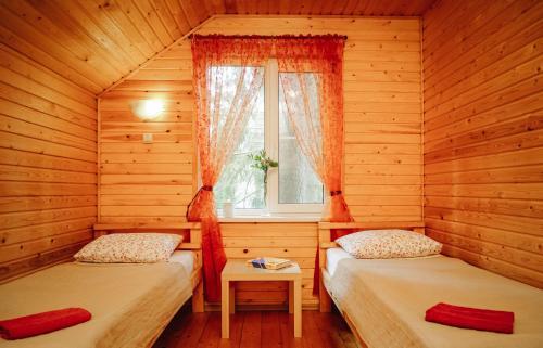 Кровать или кровати в номере Вырицкие Тарханы