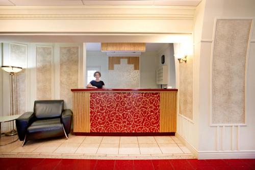 Лобби или стойка регистрации в Гостиница Аврора