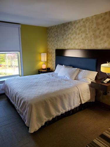 A bed or beds in a room at Home2Suites by Hilton Augusta